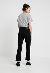 Levi's® - MILE HIGH CROP FLARE - Flared jeans - black sheep - 2