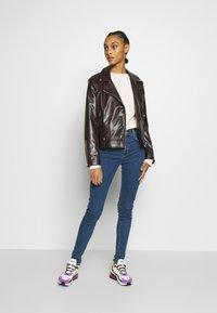 Levi's® - 720 HIRISE SUPER SKINNY - Jeans Skinny Fit - tempo stone - 1