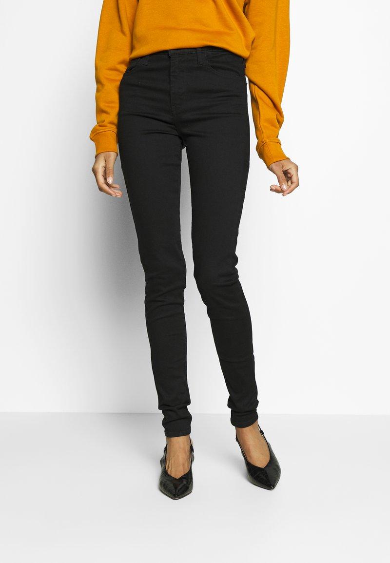 Levi's® - 720 HIRISE SUPER SKINNY - Jeans Skinny Fit - black galaxy