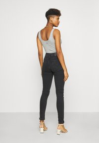Levi's® - MILE HIGH SUPER SKINNY - Jeans Skinny Fit - black haze