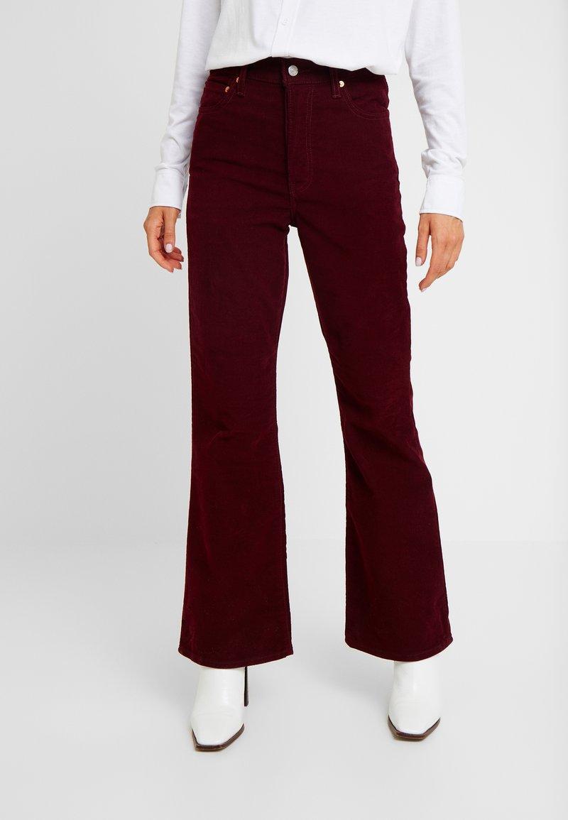 Levi's® - RIBCAGE FLARE - Trousers - shiraz