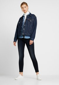 Levi's® - 710 INNOVATION SUPER SKINNY - Jeansy Skinny Fit - trick of the trade - 1