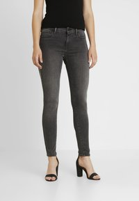 Levi's® - 710 INNOVATION SUPER SKINNY - Jeans Skinny - black denim - 0
