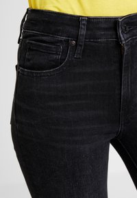 Levi's® - 721 HIRISE FRINGE ANKLE - Jeans Skinny Fit - don't give a fringe - 6