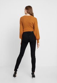 Levi's® - 721 HIGH RISE SKINNY LONG SHOT - Jean slim - black - 2