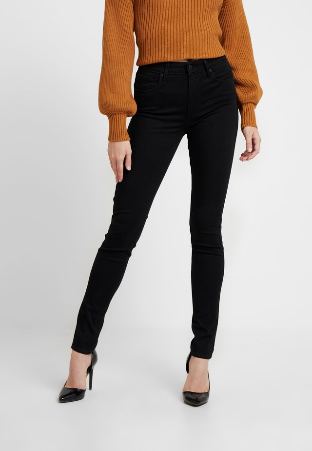 721 HIGH RISE SKINNY LONG SHOT - Slim fit jeans - black