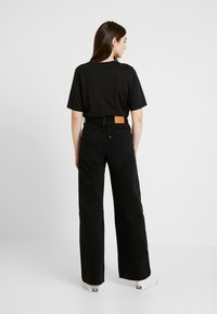 Levi's® - RIBCAGE WIDE LEG - Flared Jeans - black book - 2