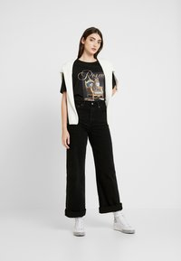 Levi's® - RIBCAGE WIDE LEG - Flared jeans - black book - 1