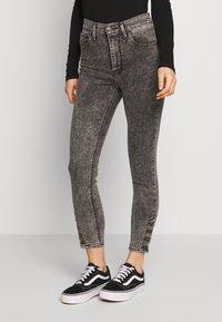 Levi's® - MILE HIGH ANK BUTTON HEM - Jeans Skinny - button on - 0