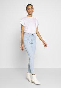 Levi's® - MILE HIGH ANK  - Jeans Skinny Fit - light blue denim - 1