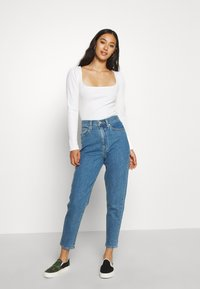 Levi's® - HIGH WAISTED TAPER - Jeansy Straight Leg - blue denim - 1
