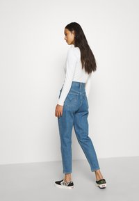 Levi's® - HIGH WAISTED TAPER - Jeansy Straight Leg - blue denim - 2