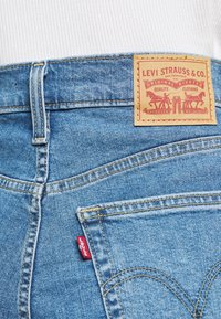 Levi's® - HIGH WAISTED TAPER - Jeansy Straight Leg - blue denim - 4
