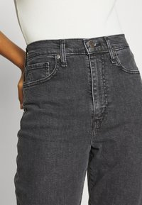 Levi's® - HIGH WAISTED TAPER - Straight leg jeans - black denim - 3