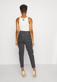 Levi's® - HIGH WAISTED TAPER - Straight leg jeans - black denim - 2