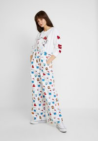 Levi's® - LEVI'S® X HELLO-KITTY BAGGY OVERALL - Tuinbroek - white - 1