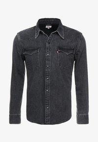 black worn