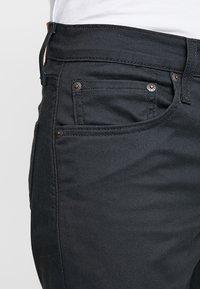 Levi's® - 512™ SLIM TAPER FIT - Trousers - caviar sorbtek - 3