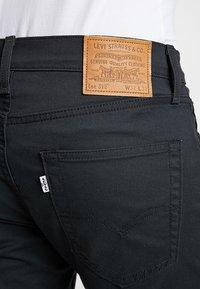 Levi's® - 512™ SLIM TAPER FIT - Trousers - caviar sorbtek - 5