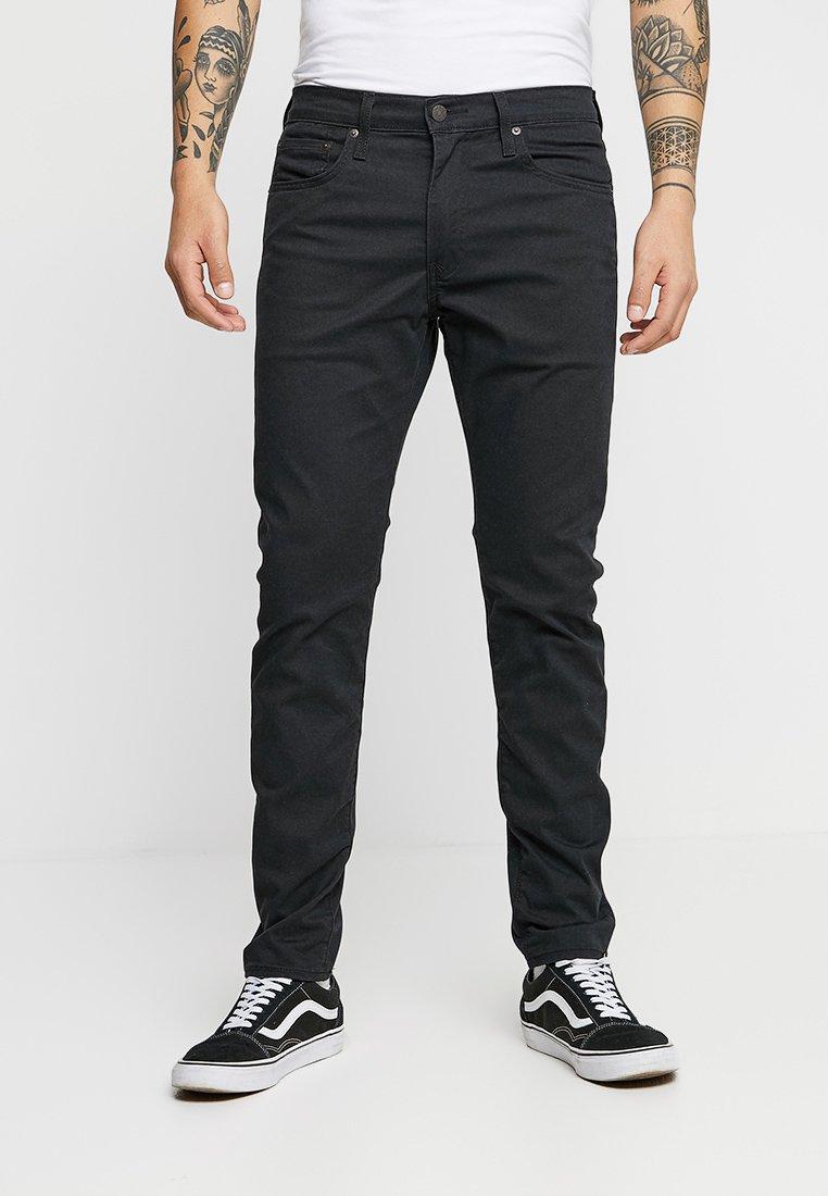 Levi's® - 512™ SLIM TAPER FIT - Trousers - caviar sorbtek