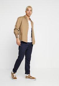 Levi's® - 502™ TRUE - Kalhoty - nightwatch blue sorbtek - 1