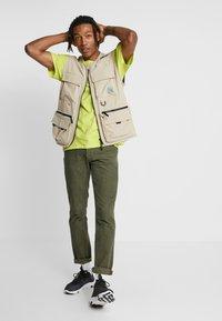 Levi's® - 511™ SLIM FIT - Kalhoty - olive night - 1