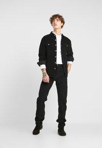 Levi's® - 502™ CARPENTER PANT - Trousers - mineral black - 1