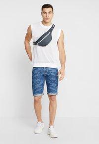 Levi's® - 501® ORIG CUTOFF SHORT - Denim shorts - blue denim - 1