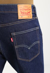 Levi's® - 502 REGULAR TAPER - Vaqueros tapered - chain rinse