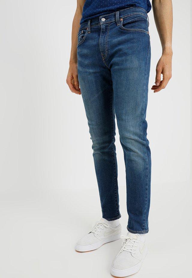 512 SLIM TAPER FIT - Jeans Tapered Fit - revolt adv