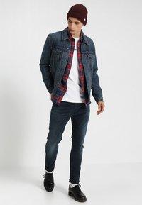 Levi's® - 512 SLIM TAPER FIT - Jeans slim fit - dark-blue denim - 1