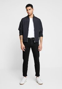 Levi's® - 501® SLIM TAPER - Jeans slim fit - black - 1