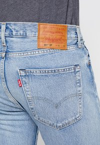 Levi's® - 501® SLIM TAPER - Slim fit jeans - revolution mid - 5