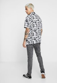 Levi's® - 511™ SLIM FIT - Jeansy Slim Fit - porcini bleach - 2