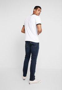 Levi's® - 511™ SLIM FIT - Slim fit jeans - dark-blue denim - 2