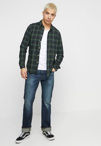 Levi's® - 527™ SLIM BOOT CUT - Bootcut jeans - durian super tint overt - 1
