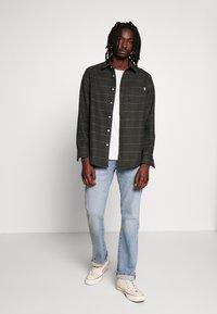 Levi's® - 527™ SLIM BOOT CUT - Bootcut jeans - fennel subtle - 1
