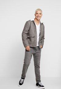 Levi's® - 512™ SLIM TAPER FIT - Jean slim - grey denim - 1