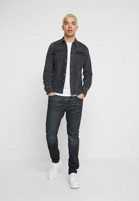 Levi's® - 512™ SLIM TAPER FIT - Jeans slim fit - dark-blue denim - 1