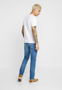 Levi's® - 512™ SLIM TAPER FIT - Džíny Slim Fit - blue denim - 2