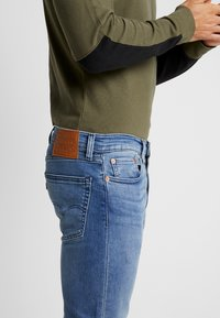 Levi's® - 502™ REGULAR TAPER - Jeans Tapered Fit - cedar light mid - 4