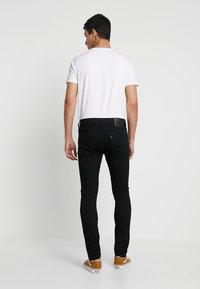 Levi's® - 519™ EXTREME SKINNY FIT - Jeans Skinny Fit - black denim - 2