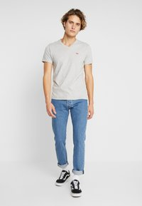 Levi's® - 501® SLIM TAPER - Džíny Slim Fit - stonewashed - 1