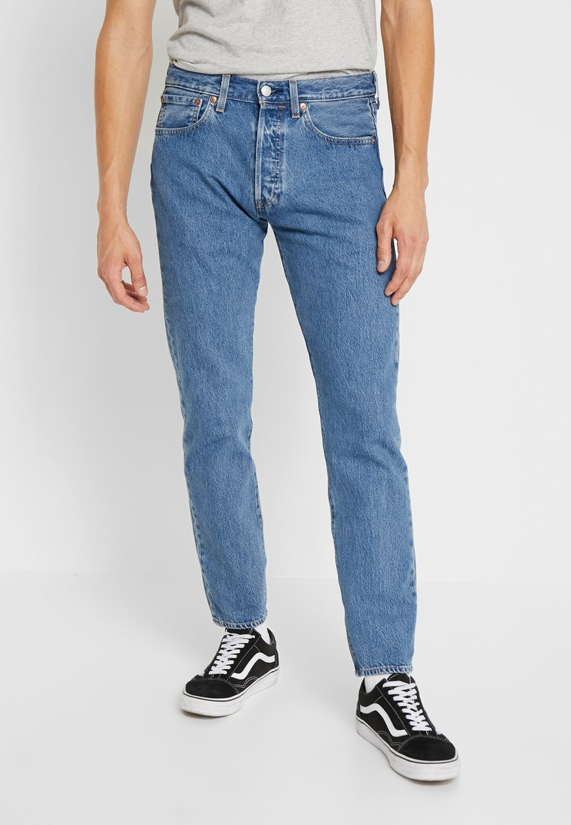 Levi's® - 501® SLIM TAPER - Džíny Slim Fit - stonewashed