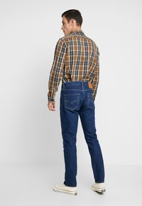 Levi's® - 511™ SLIM FIT - Jeans slim fit - orange sunset adapt - 2