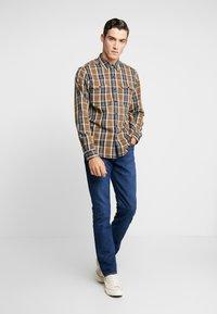 Levi's® - 511™ SLIM FIT - Jeans slim fit - orange sunset adapt - 1