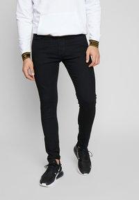 Levi's® - SKINNY TAPER - Skinny džíny - black denim - 0