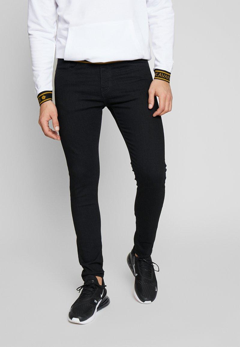 Levi's® - SKINNY TAPER - Skinny džíny - black denim