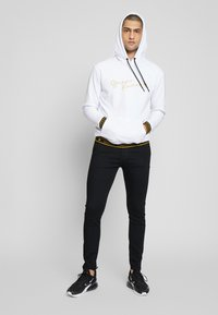 Levi's® - SKINNY TAPER - Skinny džíny - black denim - 1