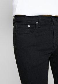 Levi's® - SKINNY TAPER - Skinny džíny - black denim - 3